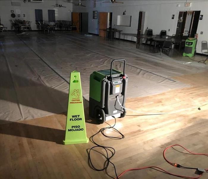 Plastic laid down on damaged area with a dehumidifier running and a