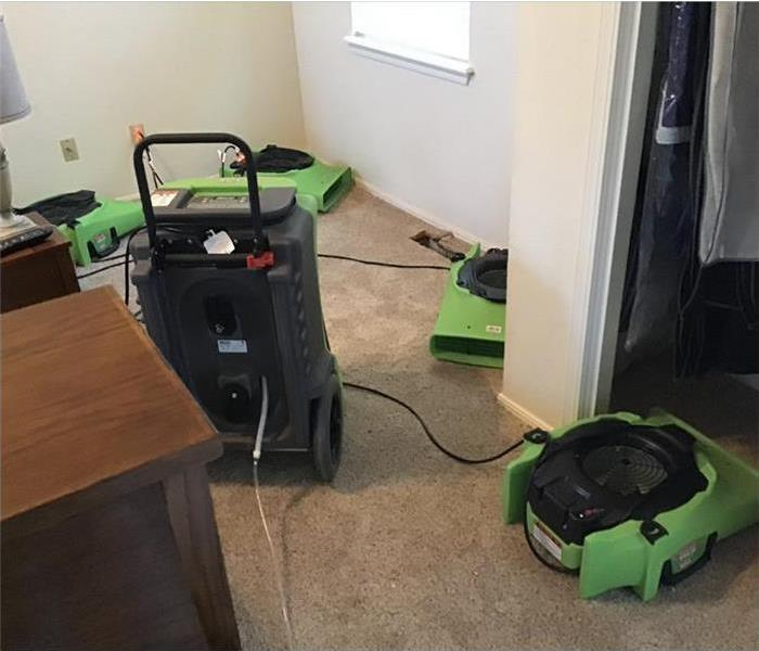Air movers and dehumidifier drying up an area that was affected by storm