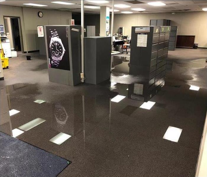 An office with standing water on carpet