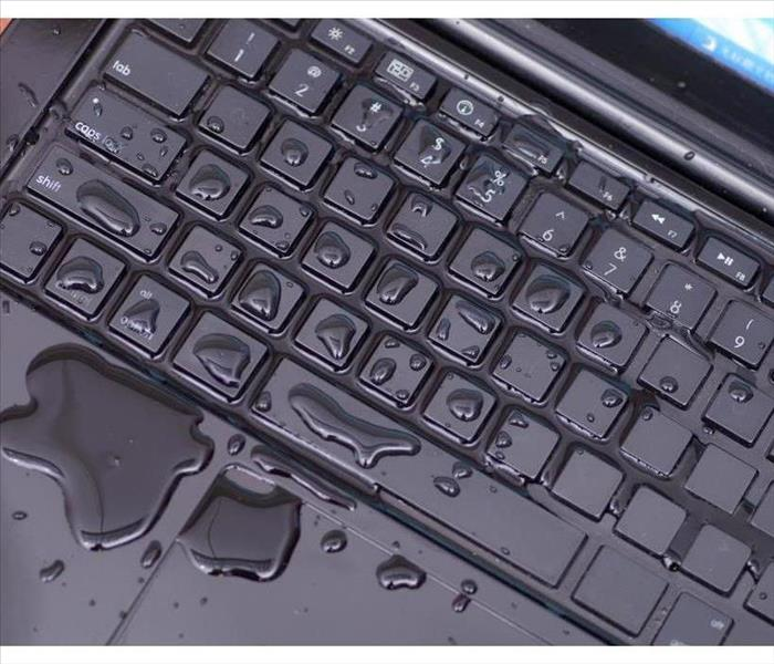 Keyboard of a computer with water drops