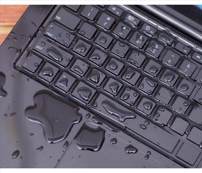 Above view of laptop with water drop damage liquid wet and spill on keyboard