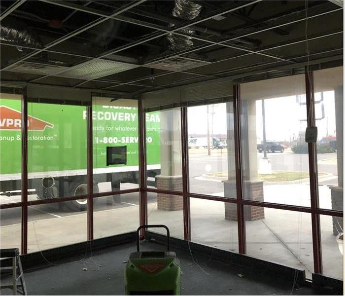 Ceiling of commercial building collapsed, SERVPRO truck parked out of the building