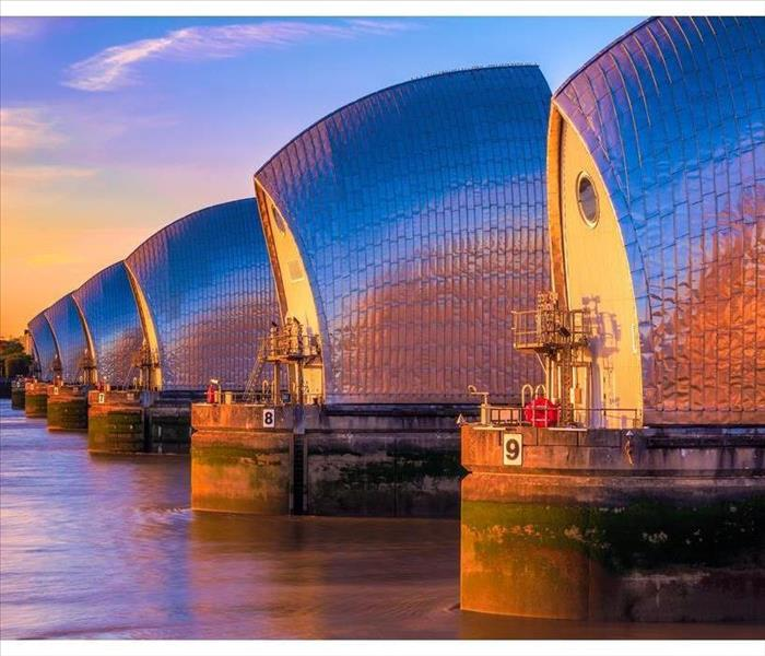 Thames Barrier, located downstream of central London at sunset